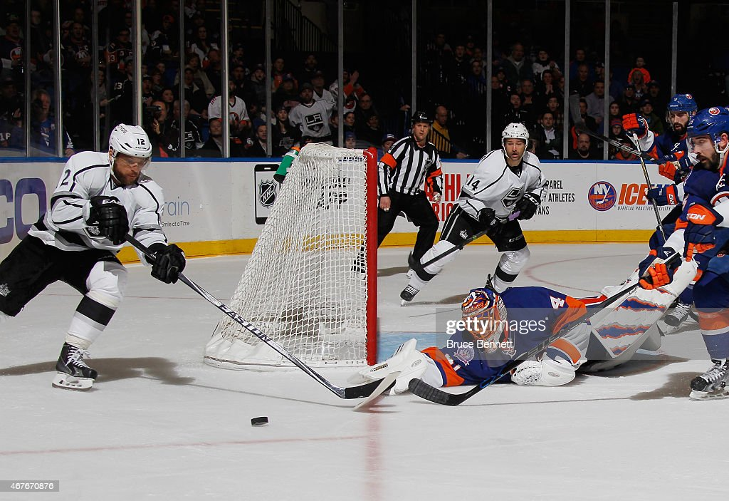 Jaroslav Halak #41 of the New York Islanders makes the save as Marian Gaborik #12 of the Los Angeles Kings looks for the rebound during the third period at the Nassau Veterans Memorial Coliseum on March 26, 2015 in Uniondale, New York. The Kings defeated the Islanders 3-2.