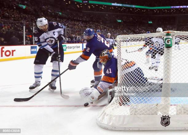 Jaroslav Halak of the New York Islanders makes the save on Blake Wheeler of the Winnipeg Jets at the Barclays Center on December 23 2017 in the...