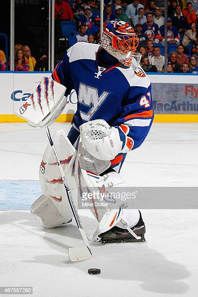Jaroslav Halak of the New York Islanders skates against the San Jose Sharks at Nassau Veterans Memorial Coliseum on October 16 2014 in Uniondale New...