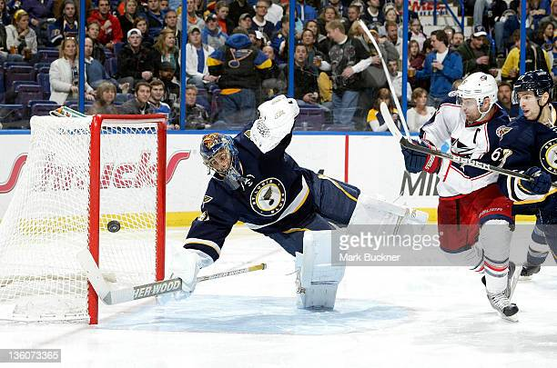 Jaroslav Halak of the St Louis Blues makes a save as Rick Nash of the Columbus Blue Jackets battles with Alex Pietrangelo of the St Louis Blues in an...
