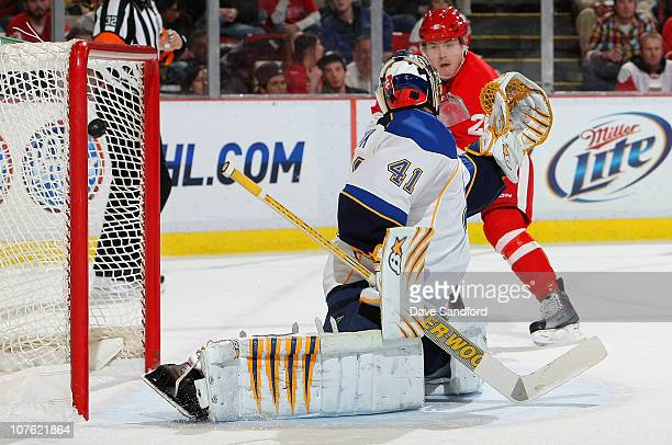 Jaroslav Halak of the StLouis Blues is beat on a shot by Niklas Kronwall of the Detroit Red Wings as Jiri Hudler of the Detroit Red Wings looks on...