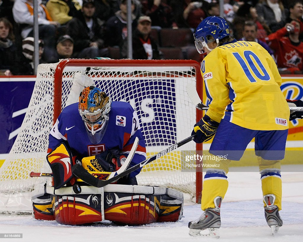 Jaroslav Janus #2 of Team Slovakia stops the puck in front of Mattias Tedenby#10 of Team Sweden during the semifinals at the IIHF World Junior Championships at the Ottawa Civic Centre on January 03, 2009 in Ottawa, Ontario, Canada.
