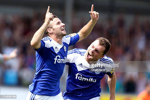 Jaroslav Lindner of Kiel celebrates after scoring their first goal during the Third Bundesliga match between Holstein Kiel and 1 FC Saarbruecken at...