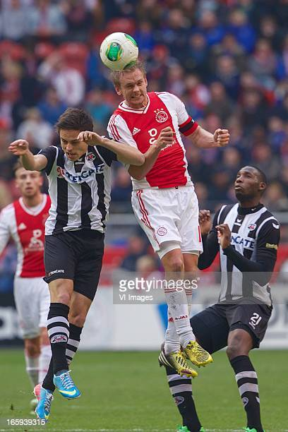 Jaroslav Navratil of Heracles Almelo Siem de Jong of Ajax Geoffrey Castillion of Heracles Almelo during the Dutch Eredivisie match between Ajax...