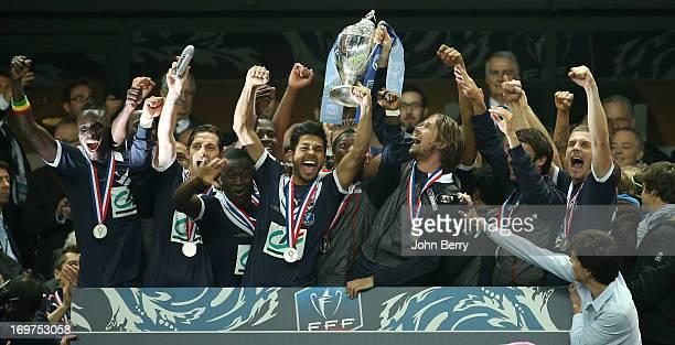 Jaroslav Plasil, captain of Bordeaux lifts the winners trophy with his teammates Ludovic Sane, Henri Saivet, Benoit Tremoulinas, Gregory Sertic after...