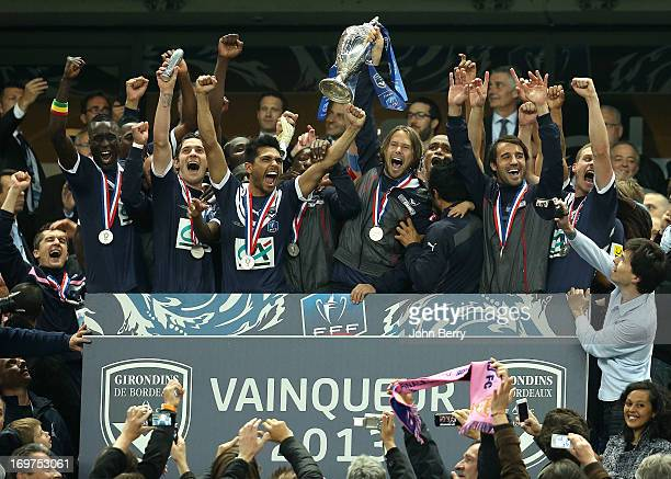 Jaroslav Plasil, captain of Bordeaux lifts the winners trophy with his teammates Ludovic Sane, Benoit Tremoulinas, Marc Planus after the French Cup...