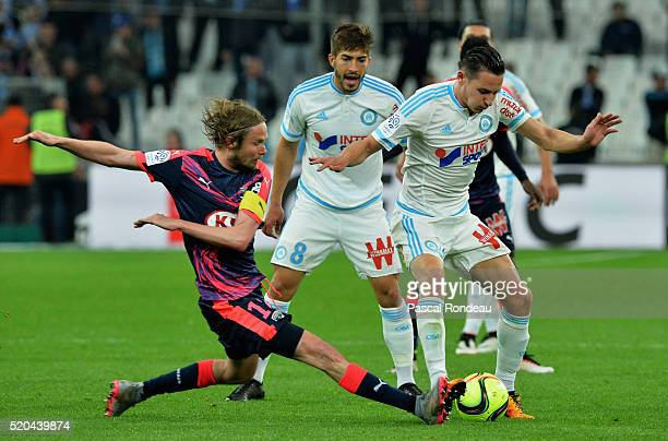 Jaroslav Plasil from Bordeaux tacle the ball in front of Florian Thauvin from Marseille during the French League 1 match between Olympique de...
