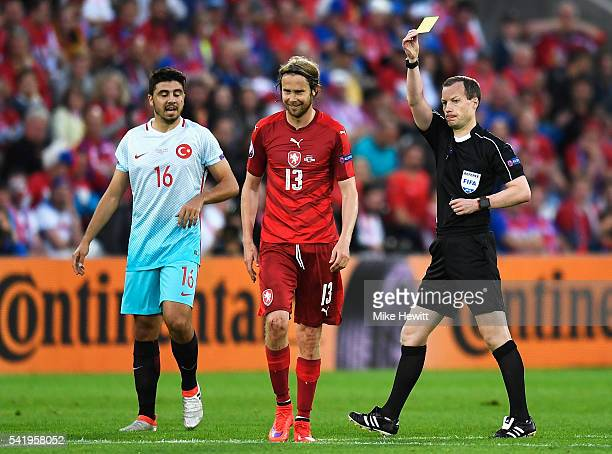 Jaroslav Plasil of Czech Republic is shown a yellow card by referee William Collum during the UEFA EURO 2016 Group D match between Czech Republic and...
