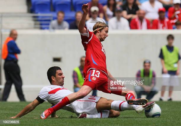 Jaroslav Plasil of Czech Republic is tripped up by Arda Turan of Turkey during their International Friendly match on May 22 2010 at Red Bull Arena in...