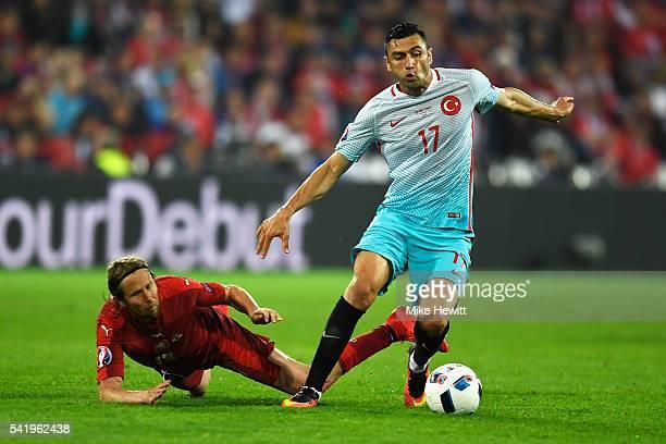 Jaroslav Plasil of Czech Republic tackles Burak Yilmaz of Turkey during the UEFA EURO 2016 Group D match between Czech Republic and Turkey at Stade...