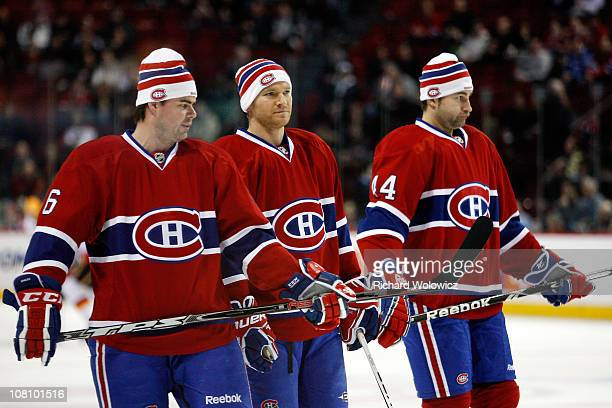 Jaroslav Spacek Jeff Halpern and Roman Hamrlik of the Montreal Canadiens warm up in their Heritage Classic Tuques prior to facing the Calgary Flames...