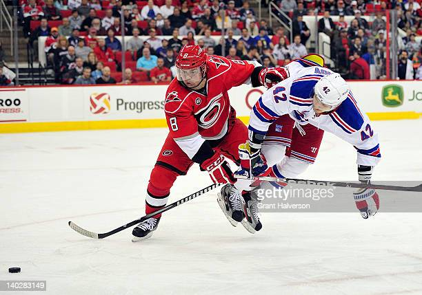 Jaroslav Spacek of the Carolina Hurricanes knocks Artem Anisimov of the New York Rangers off the puck during play at the RBC Center on March 1 2012...