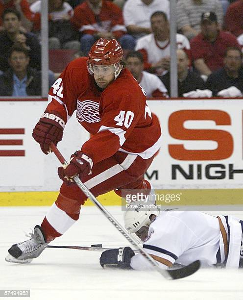 Jaroslav Spacek of the Edmonton Oilers makes a diving pokecheck to knock the puck of the stick of Henrik Zetterberg of the Detroit Red Wings in game...
