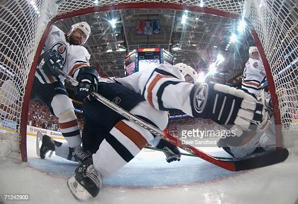 Jaroslav Spacek of the Edmonton Oilers protects the goalline with his stick as Steve Staios falls onto the ice during the first period of game seven...