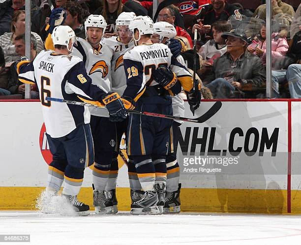 Jaroslav Spacek Tim Connolly Drew Stafford and Jason Pominville of the Buffalo Sabres celebrate a goal against the Ottawa Senators at Scotiabank...