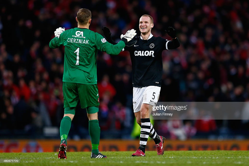 Jaroslaw Fojut of Dundee United celebrates with goalkeeper, Radoslaw Cierzniak at full time after the Scottish League Cup Semi-Final match between Dundee United and Aberdeen at Hampden Park on January 31, 2015 in Glasgow, Scotland.