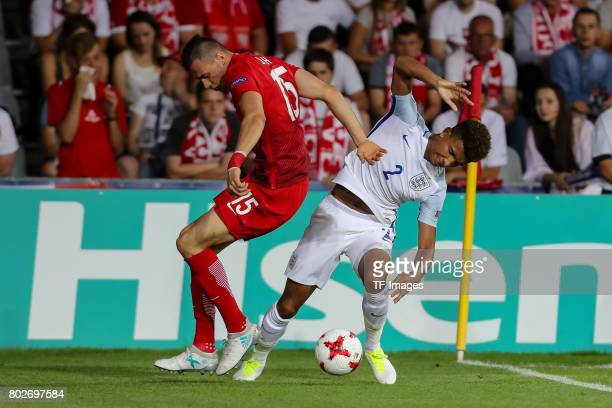 Jaroslaw Jach of Poland and Mason Holgate of England battle for the ball during the UEFA European Under21 Championship Group A match between England...