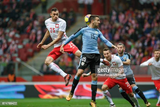 Jaroslaw Jach of Poland and Matias Vecino of Uruguay during international friendly match between Poland and Uruguay at National Stadium on November...