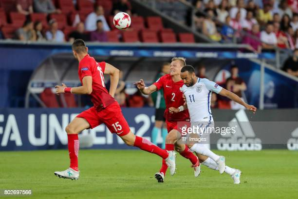 Jaroslaw Jach of Poland Pawel Jaroszynski of Poland and Nathan Redmond of England battle for the ball during the UEFA European Under21 Championship...