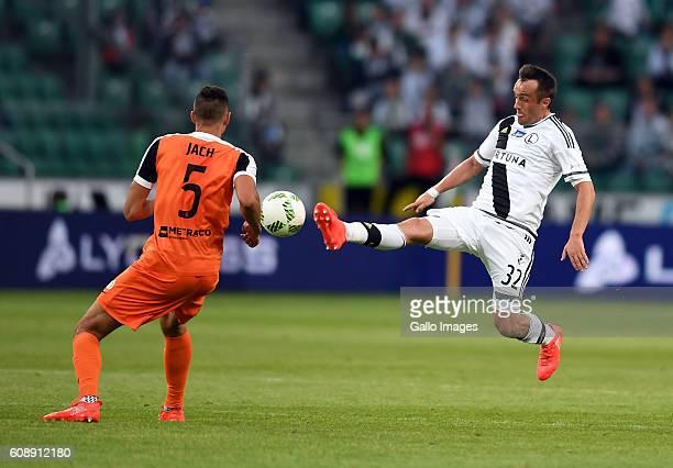 OUT Jaroslaw Jach of Zaglebie Lubin ad Miroslav Radovic of Legia Warszawa in action during the LOTTO Extraklasa match between Legia Warszawa and...