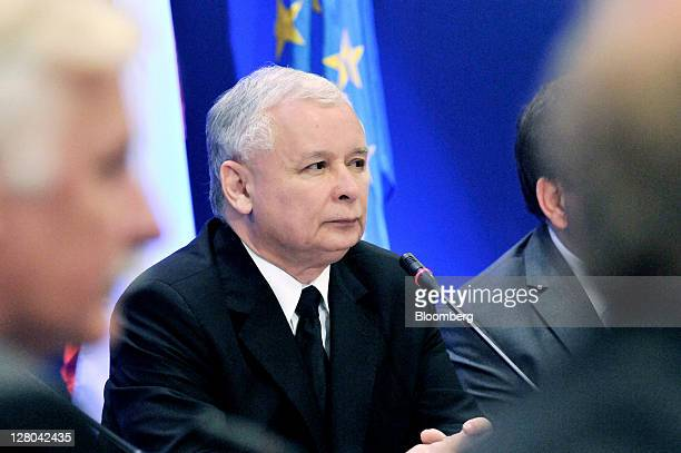 Jaroslaw Kaczynski center leader of the Law Justice party speaks during a meeting to introduce his proposed cabinet before Sunday's national election...