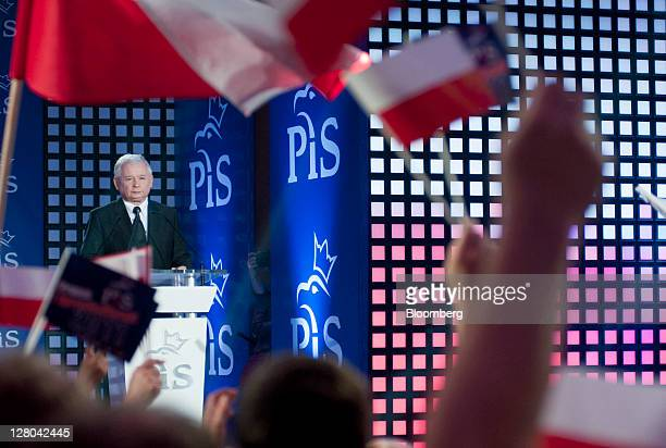 Jaroslaw Kaczynski leader of the Law Justice party speaks to flagwaving supporters during a rally in Warsaw Poland on Sunday Oct 2 2011 Kaczynski...