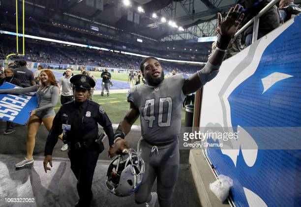 Jarrad Davis of the Detroit Lions celebrates with fans the Lions victory over the Panthers 20-19 at Ford Field on November 18, 2018 in Detroit,...