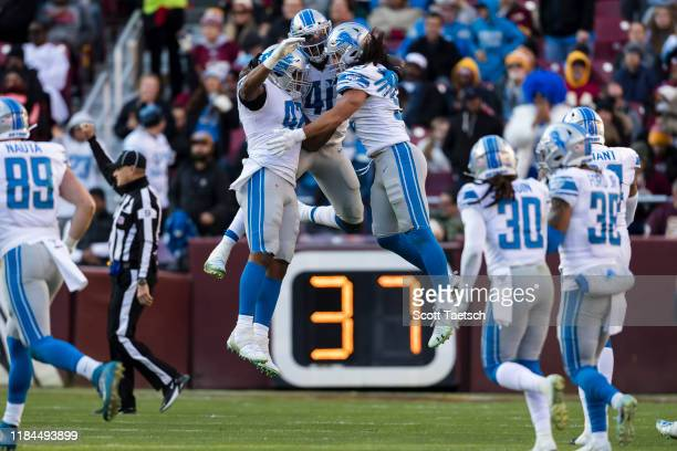 Jarrad Davis of the Detroit Lions celebrates with teammates after a play against the Washington Redskins during the second half at FedExField on...