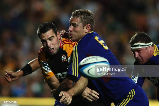 Jarrad Hoeata of the Highlanders tackles Nick Crosswell of the Chiefs during the round six Super Rugby match between the Chiefs and the Highlanders...