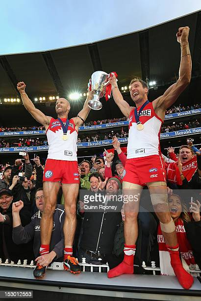 Jarrad McVeigh and Jude Bolton of the Swans celebrate with the Premiership Cup after winning the 2012 AFL Grand Final match between the Sydney Swans...