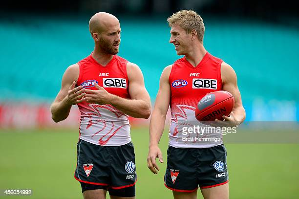 Jarrad McVeigh and Kieren Jack of the Swans speak during a Sydney Swans AFL training session at Sydney Cricket Ground on September 25 2014 in Sydney...