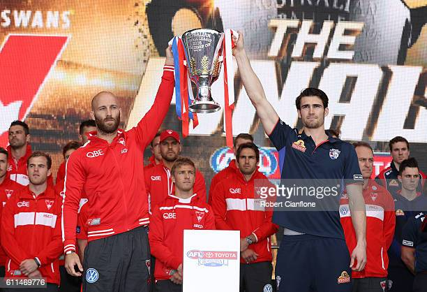 Jarrad McVeigh of the Swans and Easton Wood of the Bulldogs hold aloft the AFL Premiership Trophy during the 2016 AFL Grand Final Parade on September...