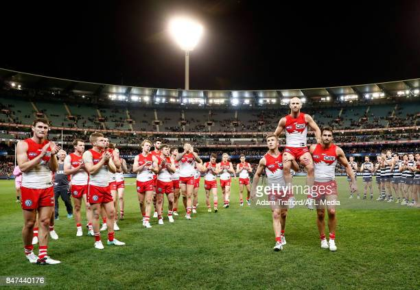 Jarrad McVeigh of the Swans is chaired off after his 300th game by Kieren Jack and Josh Kennedy of the Swans during the 2017 AFL Second Semi Final...