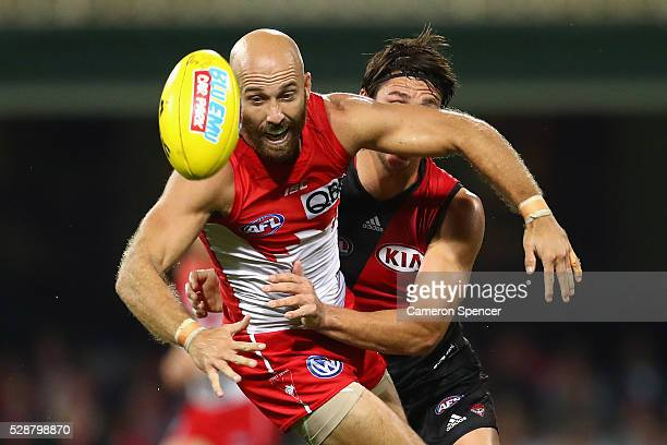 Jarrad McVeigh of the Swans is tackled by Mark Baguley of the Bombers during the round seven AFL match between the Sydney Swans and the Essendon...