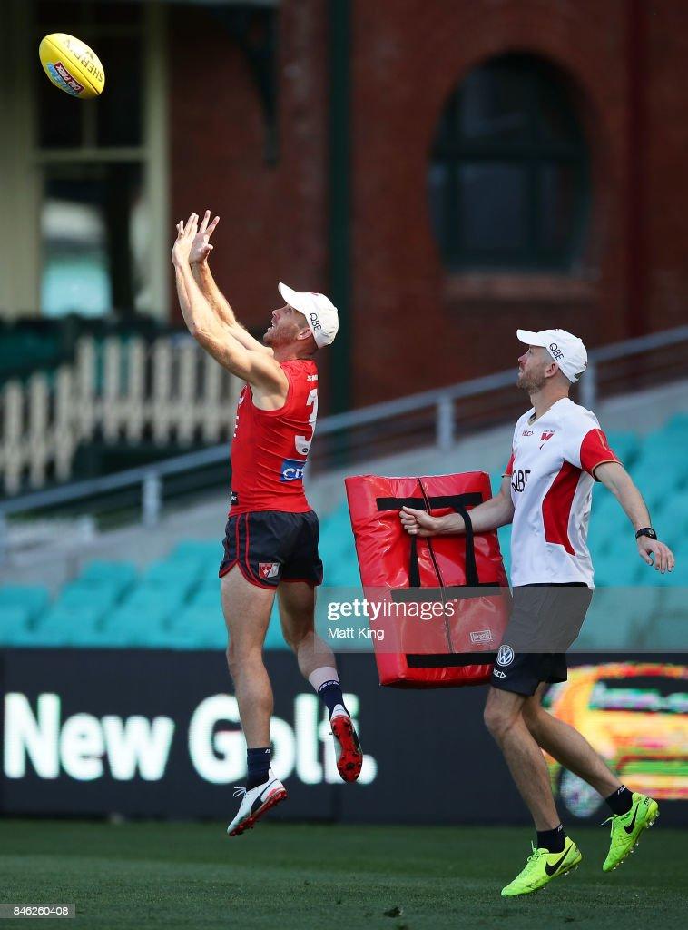 Jarrad McVeigh of the Swans practises marking during a Sydney Swans AFL training session at Sydney Cricket Ground on September 13, 2017 in Sydney, Australia.
