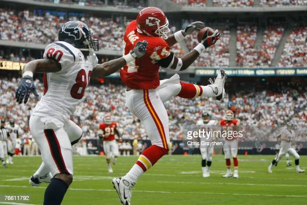 Jarrad Page of the Kansas City Chiefs intercepts a ball in the endzone intended for Andre Johnson of the Houston Texans at Reliant Stadium September...