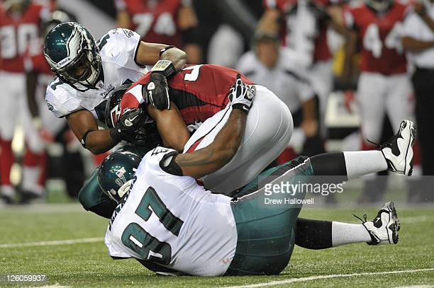 Jarrad Page of the Philadelphia Eagles makes a tackle during the game against the Atlanta Falcons at the Georgia Dome on September 18 2011 in Atlanta...