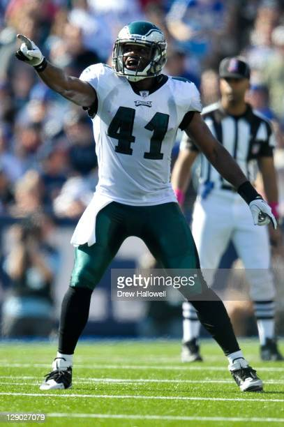 Jarrad Page of the Philadelphia Eagles points during the game against the Buffalo Bills at Ralph Wilson Stadium on October 9 2011 in Orchard Park New...