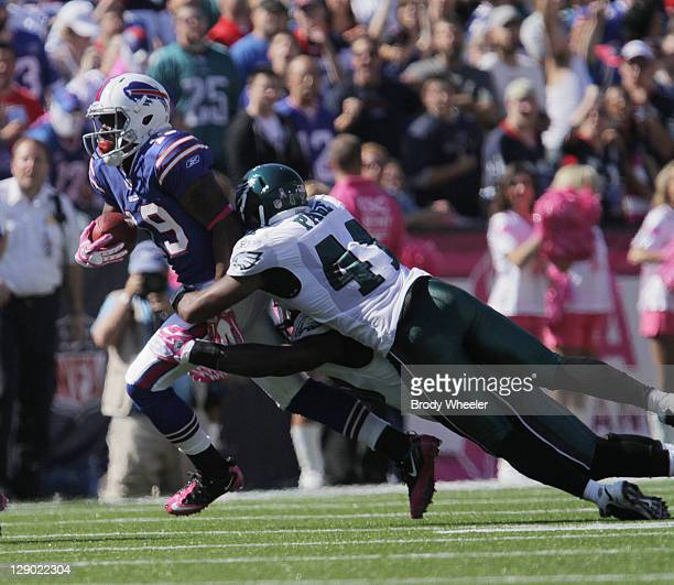 Jarrad Page of the Philadelphia Eagles tackles Stevie Johnson of the Buffalo Bills during the first half at Ralph Wilson Stadium on October 9 2011 in...