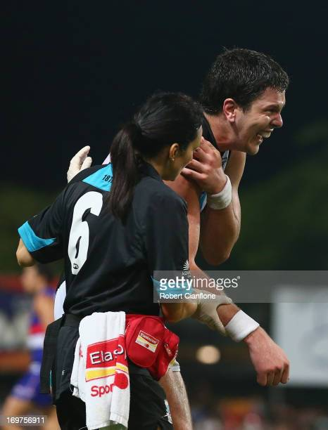 Jarrad Redden of the Power is taken from the ground with an injury during the round ten AFL match between the Western Bulldogs and Port Adelaide...
