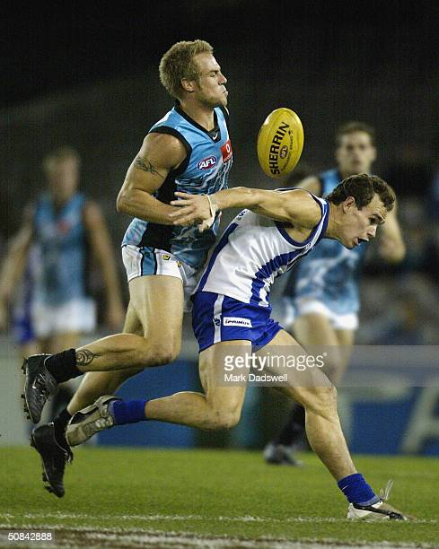 Jarrad Schofield for the Power competes with Corey Jones for the Kangaroos during the round eight AFL match between the Kangaroos and the Port...
