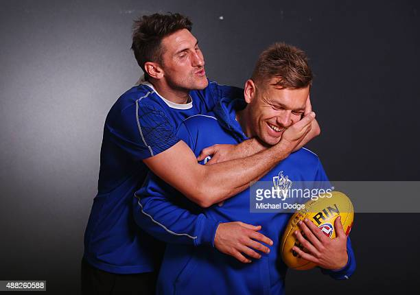 Jarrad Waite attempts to kiss Shaun Higgins while posing during a North Melbourne Kangaroos AFL media session at Arden Street Ground on September 15...