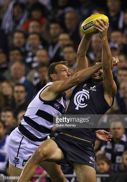 Jarrad Waite of the Blues marks infront of Darren Milburn of the Cats during the round nine AFL match between the Carlton Blues and the Geelong Cats...