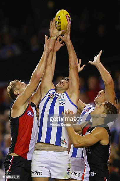 Jarrad Waite of the Kangaroos compete for the ball against Sam Gilbert and Sean Dempster of the Saints during the round seven AFL match between the...