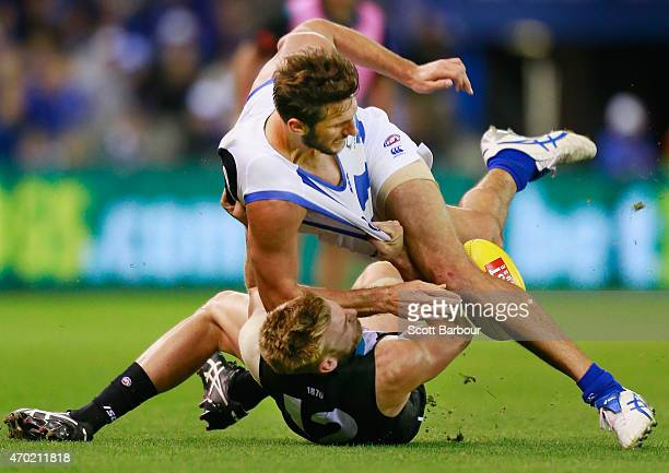 Jarrad Waite of the Kangaroos is tackled by Jackson Trengove of the Power during the round three AFL match between the North Melbourne Kangaroos and...