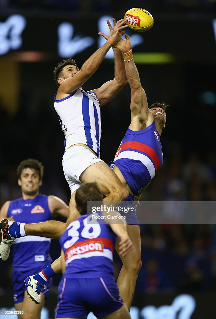 Jarrad Waite of the Kangaroos leaps as he attempts to mark during the round six AFL match between the North Melbourne Kangaroos and the Western Bulldogs at Etihad Stadium on April 29, 2016 in Melbourne, Australia.