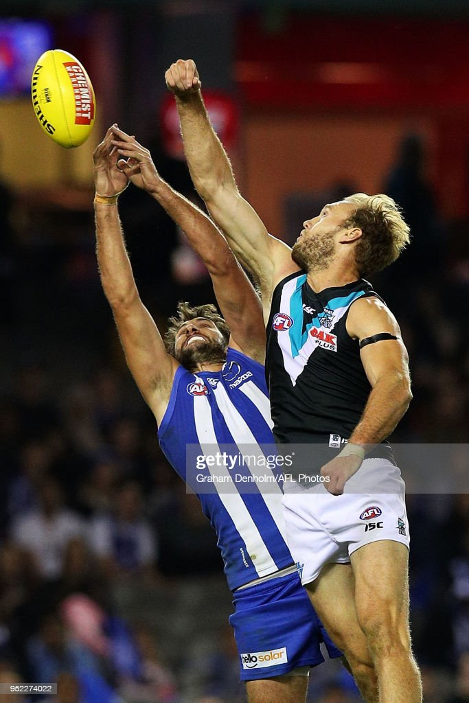Jarrad Waite of the Kangaroos (L) leaps for a mark during the round six AFL match between the North Melbourne Kangaroos and Port Adelaide Power at Etihad Stadium on April 28, 2018 in Melbourne, Australia.