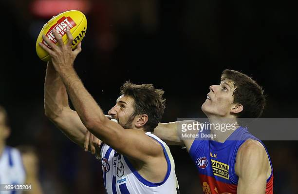 Jarrad Waite of the Kangaroos marks the ball against Justin Clarke of the Lions during the round two AFL match between the North Melbourne Kangaroos...