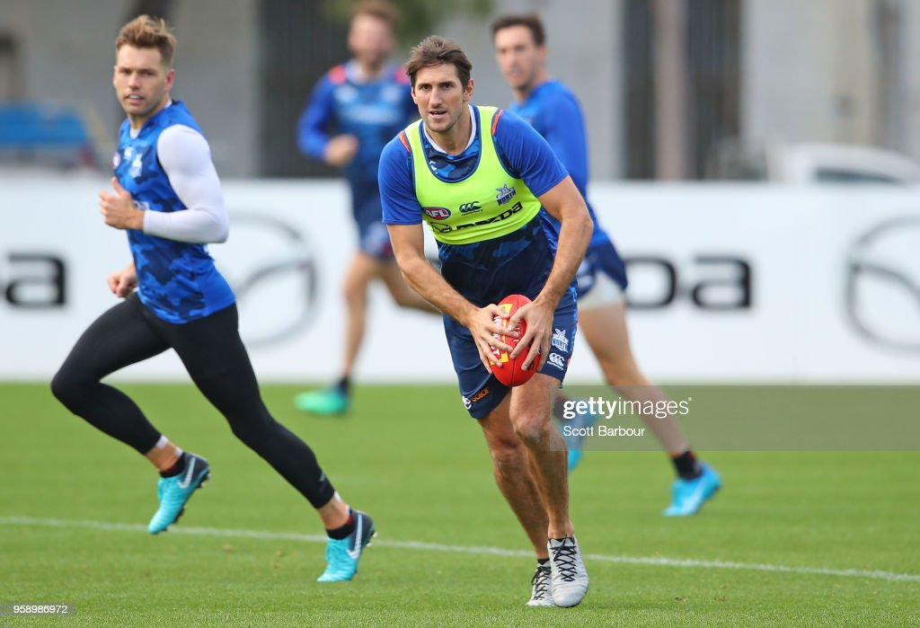 Jarrad Waite of the Kangaroos runs with the ball during a North Melbourne Kangaroos AFL training session at Arden Street Ground on May 16, 2018 in Melbourne, Australia.