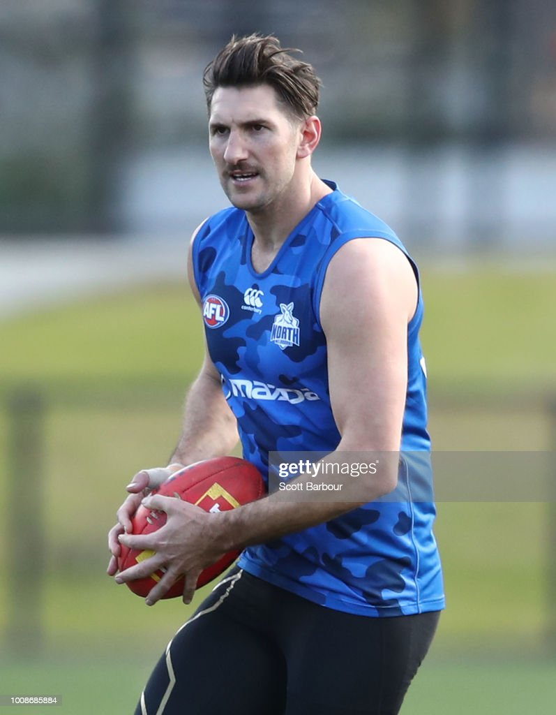 Jarrad Waite of the Kangaroos runs with the ball during an North Melbourne Kangaroos AFL training session at Arden Street Ground on August 1, 2018 in Melbourne, Australia.